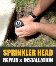 a contractor is changing a sprinkler head